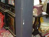 Chimney Cabinet has black, distressed finish, and