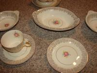 12 piece china set, with many extra serving pieces.