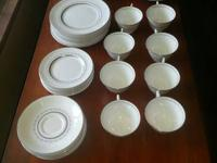 8 Place setting of fine Bone China by Royal Doulton.