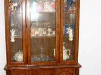 Lighted china cabinet. one side is missing glass .