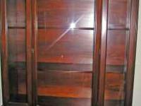 I purchased this china cabinet in auctions- it belonged