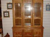 Lighted china cabinet in very nice condition. Take