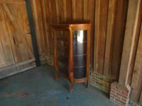 Oak China cabinet, curved glass, great condition.