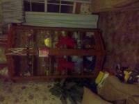Real wood China cabinet in good condition. Asking