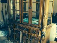 Exquisite strong wood lighted china cabinet. Felt on