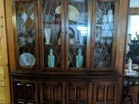 Large china cabinet for sale. 3 shelves behind glass