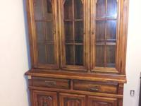 This cabinet has 3 glass shelves on the top and great
