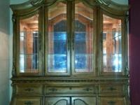 I am selling a giant stunning art van China cabinet in