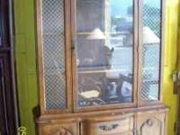 Approximately 20 different china hutch/cabinets and