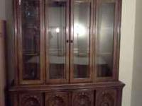 Large China Cabinet/Hutch. Lighted. It is two pieces,