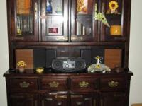 Beautiful hutch, dark wood with brass handles. Lighted