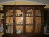 This china cabinet is a good sized one it has 3 drawers