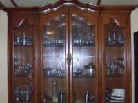 "2 piece china cabinet. The bottom piece is 2' 4"" tall x"