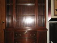 This is a beautiful lighted China Cabinet . Cabinet