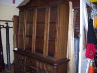 Wooden China Hutch in good condition. It is being kept