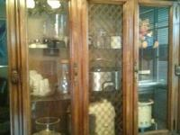It's a beautiful double lighted china hutch. Two