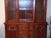 Solid, dark hard wood hutch. It has 3 drawers & 2 doors