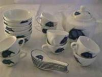 21 piece China tea set. White with blue fish, asian
