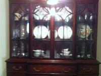 This Mahogany two piece china cabinet/breakfront has