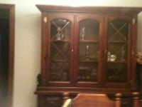 Strong wood china hutch. Leading part has lights and