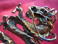 This is a chinese dragon ring, sterling silver size 7.