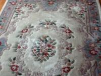 "Chinese wool area rug. Approximately 6' x 9'. 5"" Fringe"