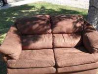 Chocolate brown love seat and couch comes with cleaning