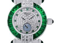Dial: Round brilliant diamond dial with emerald
