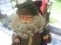 (1) OLD WORLD X-MAS SANTA, HOLDING A LANTERN & STAFF.
