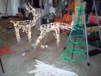 2 light up with motion white deer. and 2 outdoor