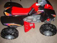 Red/Black Kawaski 4-wheeler, drives 2 speeds forward &