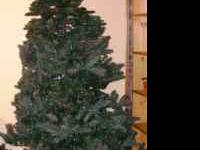 8 feet tall - christmas tree with rollers and bag. .