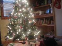 I have a 6 1/2 foot Christmas tree for sale. It is /