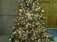 7.5 foot Christmas tree in very good condition. The