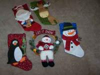 4 Christmas Stockings, and a snowman wreath fro the