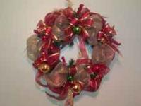 This Christmas Wreath is decorated in reds, golds, and