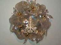 This wreath has shiny gold decorative mesh and wired