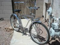 Chromed out radical cruiser, has twisted pedals