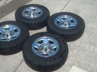 Up for sale is a set of four wheels and tires removed