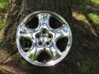 Two chrome wheels for 2001 PT Cruiser in excellent