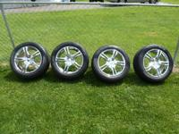 Set of 4 chrome wheels and tires. Wheels are Saber 292C