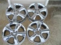 A set of 17x6 Chrome wheels removed from a 2003
