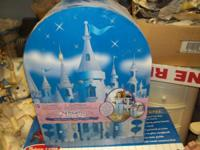 Enclosed in the cute Cinderella's Castle case, is a