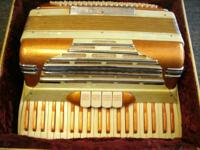 Classic pearl colored accordion. Made in Italy. Sounds