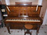 For Sale Circa 1880-1900 burled walnut upright piano.