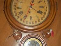 Schoolhouse calendar clock, circa 1880, with a molded