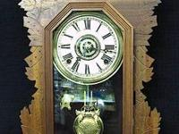 This old solid wood kitchen clock was made in the early