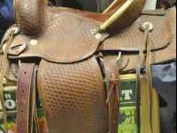 16 inch western roping/trail saddle. Basket weave