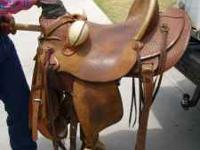 "Circle Y Roping Saddle. Basket Weave design. 16"" seat."