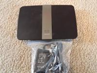 I have a Cisco Linksys E4200 available, bought new for